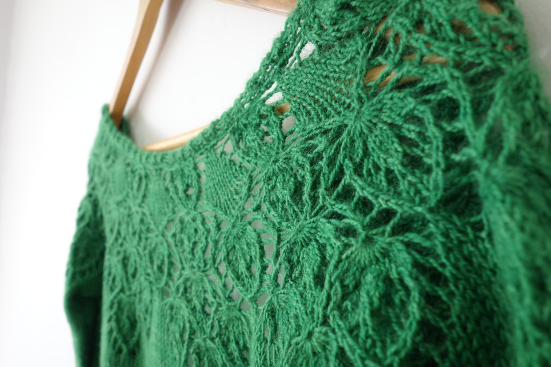 Handknitted lace cardigan